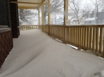 Snow drifts on porch